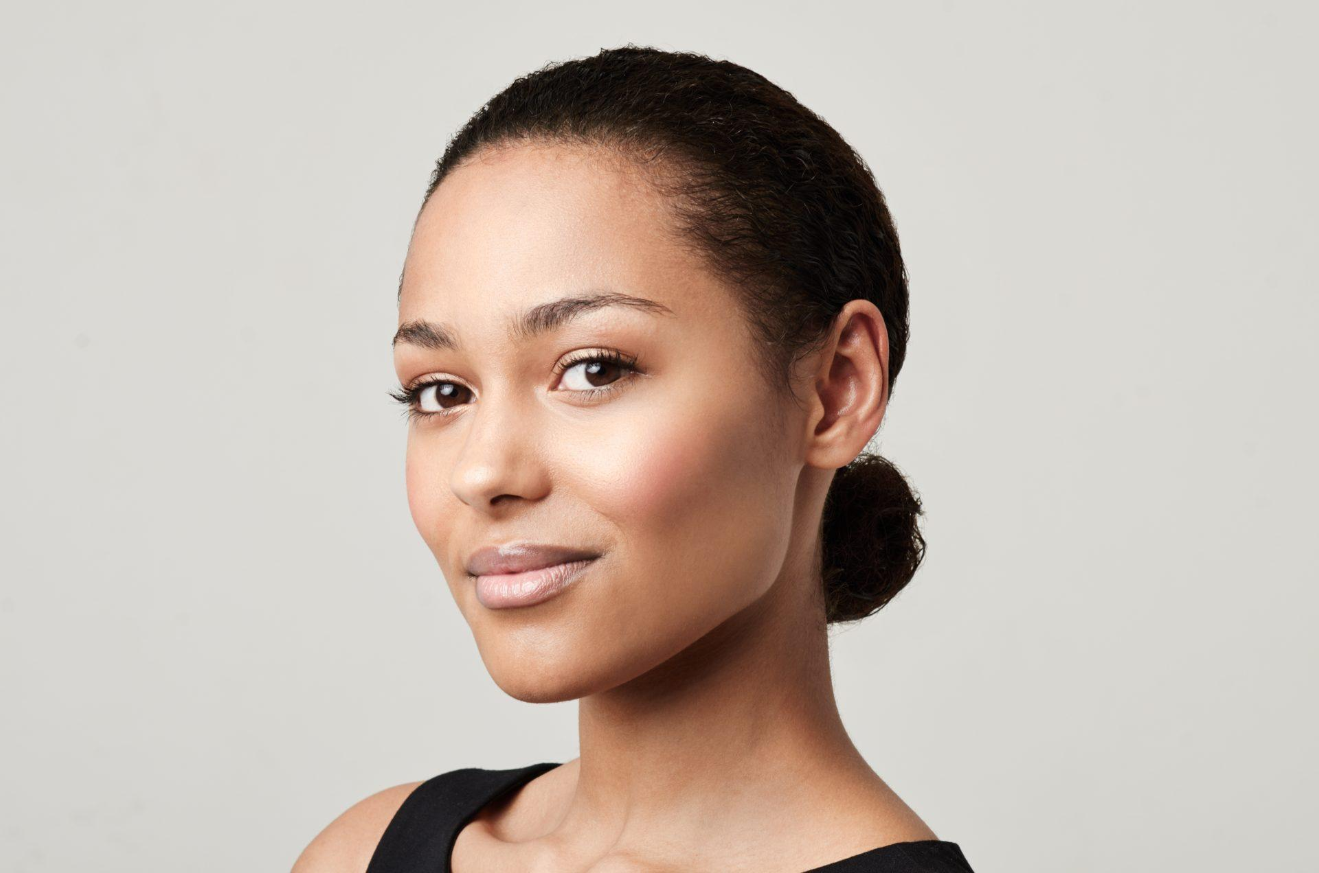 Head shot of a beautiful ethnic woman with sleeked back hair
